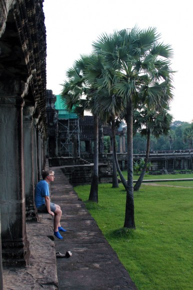 A-tourist-enjoying-the-beauty-of-Angkor-Wat-temple